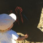 Marcella van Zanten. child drawing on blackboard